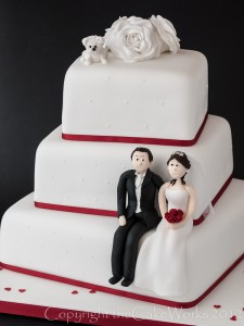 Wedding cake with bride and groom and their pet dog Rocky
